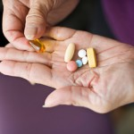 Pills in older woman's hands 5-20-11-2