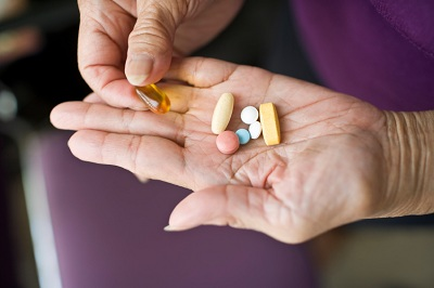 Pills in older woman&#039;s hands 5-20-11-2