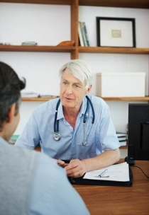 Doctor advising a client while at the office