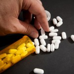 Taking Narcotic Pills, a leading prescription drug that is abused.
