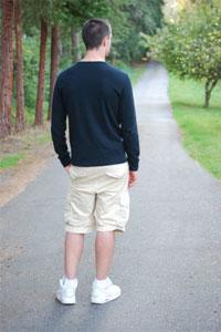 Teen boy facing road