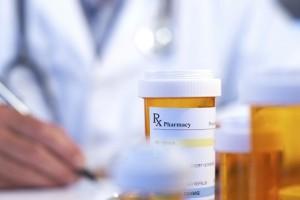 doctor writing prescription 12-18-14