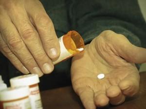 hand with prescription pill 5-20-15