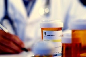 doctor writing prescription 7-30-15