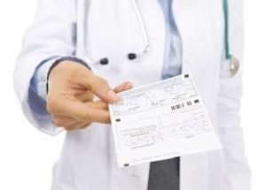 Closeup on doctor woman giving prescription