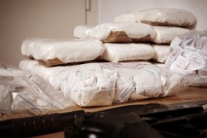 Drug criminality - packages and dozens of drugs and raw opium